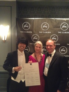 Sean Chen celebrates his Crystal Award with his Cliburn host family.